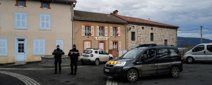 French Gendarmes stand in front of the city hall in Saint-Just, central France on December 23, 2020, after three gendarmes were killed and a fourth wounded by a gunman they confronted in response to a domestic violence call. Picture: AFP.