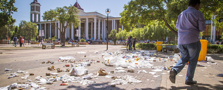 Striking cleaning staff at the University of the Western Cape tipped over bins and left litter strewn over the campus on Monday 22 February 2016. Picture: Aletta Harrison/EWN.