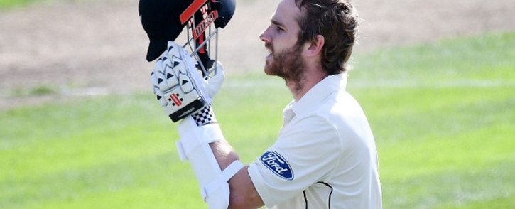 New Zealand's captain Kane Williamson celebrates 100 runs during day three of the 1st International cricket test match between New Zealand and South Africa at the University Oval in Dunedin on 10 March 2017. Picture: AFP.