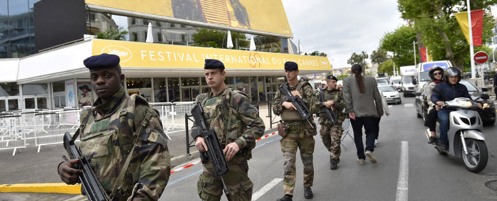French soldiers patrol in front of the Festival Palace in Cannes on 10 May 2016, on the eve of the beginning of the 69th Cannes film festival. Picture: AFP.