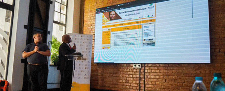 Sassa Western Cape acting regional manager Abraham Mahlangu demonstrates how the process of booking a disability grant medical assessment online goes. Picture: @OfficialSASSA/Twitter.
