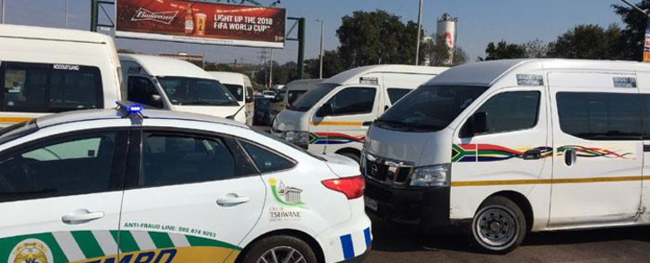 Taxi drivers block the road leading into Atteridgeville on 29 May 2018. Picture: Ihsaan Haffejee/EWN