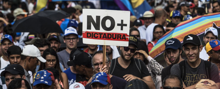 FILE: Venezuelan opposition activists protest against the government of President Nicolas Maduro in Caracas on 15 May 2017. Picture: AFP