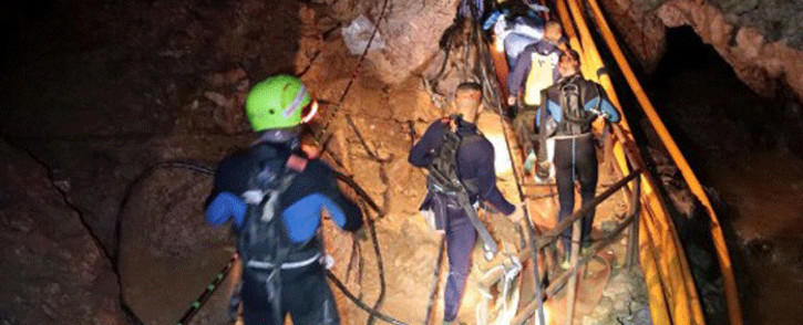 FILE: A group of Thai Navy divers are seen in Tham Luang cave during rescue operations for the 12 boys and their football team coach. Picture: AFP.
