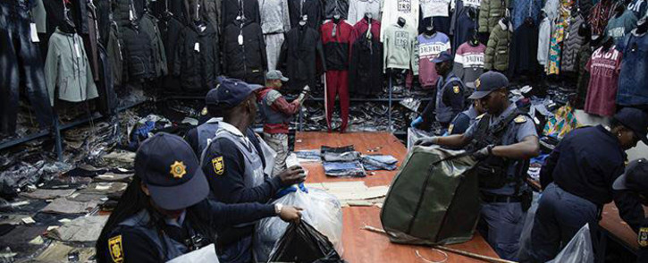 Members of the South African Police Service (SAPS) raided shops in the Johannesburg CBD on 7 August 2019 and confiscated counterfeit goods as part of an operation. Picture: Sifiso Zulu/EWN.