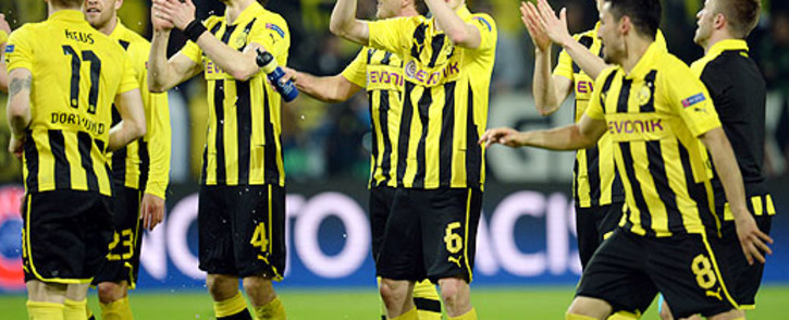 Borussia Dortmund players celebrate after their 4-1 win over Real Madrid in their first leg semifinal of the UEFA Champions League on 24 April 2013. Picture: AFP