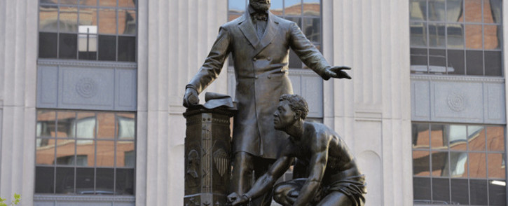 """The Abraham Lincoln Statue, erected in 1879, by Thomas Ball, is viewed in Park Square in Boston, Massachusetts on June 16, 2020. The statue is a copy of the """"Emancipation Memorial"""" in Washington DC and represents Lincoln freeing African American slaves at the end of the US Civil War. Picture: AFP."""
