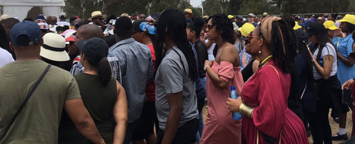 Scores of people making their way through one of the gates at the FNB stadium for the Global Citizen concert on 2 December 2018. Picture: Katleho Sekhotho/EWN