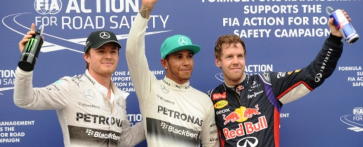 FILE: Title-chasing Lewis Hamilton (centre) has ruled out enlisting the services of a sports psychologist even if his Mercedes Formula One bosses have consulted one. Picture: AFP.