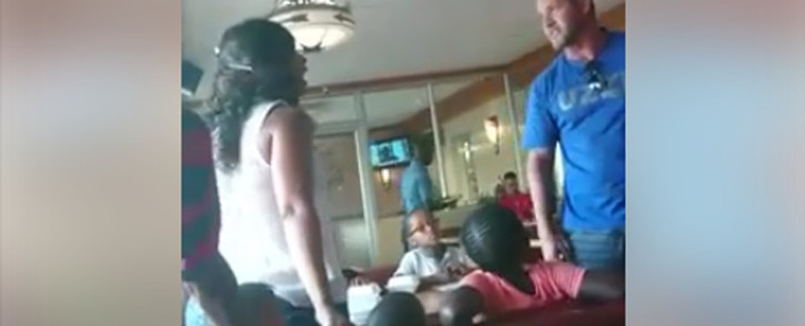 A screengrab of a video taken at the Spur at The Glen where a white man threatens to hit a black woman.