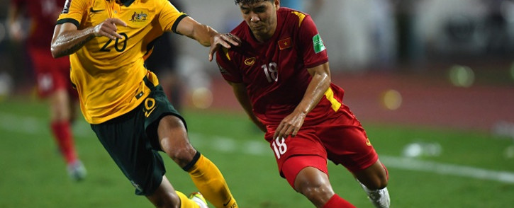 Australia's defender Trent Sainsbury (L) and Vietnam's forward Duc Chinh Ha vie for the ball during the FIFA World Cup Qatar 2022 qualifying round Group B football match between Vietnam and Australia at the My Dinh National Stadium in Hanoi on September 7, 2021. Picture: Manan VATSYAYANA / AFP