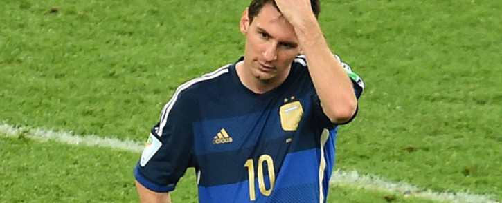 Argentina's forward and captain Lionel Messi reacts after losing the 2014 Fifa World Cup final football match between Germany and Argentina at the Maracana Stadium in Rio de Janeiro on 13 July, 2014. Picture: AFP.