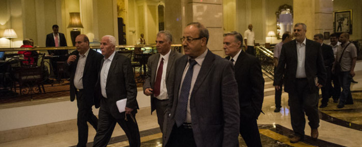 Head of the Palestinian delegation, Azzam al-Ahmad (2nd Left), and others members of the delegation in Cairo in August 2014. Picture: AFP