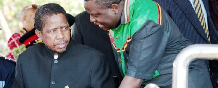 FILE: Edgar Lungu (l) talks to foreign affairs minister Harry Kalaba during a military exhibition march past on 24 October, 2014 to mark Zambia's 50th Independence celebration. Picture: AFP.