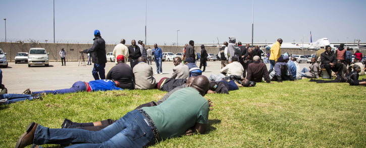 FILE: Metered taxi drivers wait to be addressed by a representative from the MEC's office at the OR Tambo Airport after they blocked main roads to the airport in protest of Uber. Picture: Thomas Holder/EWN