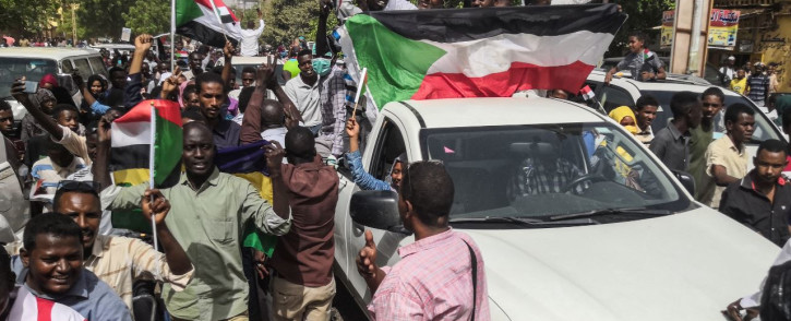 Sudanese protesters march towards the military headquarters during an anti-regime rally in the capital Khartoum on 11 April 2019. Picture: AFP.