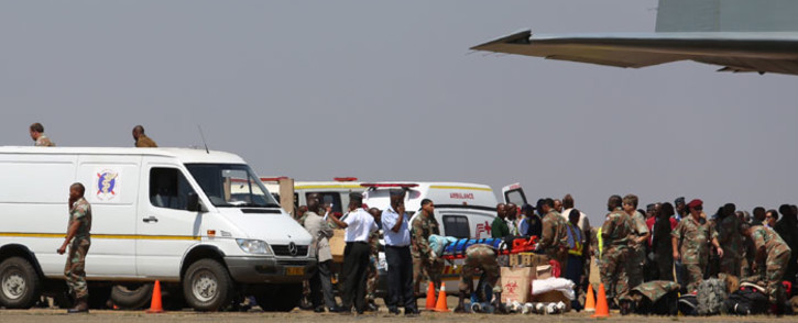 The plane carrying 25 South Africans, including three children, who were injured in the Lagos building collapse more than week ago landed at the Swartkop Air Force Base in Pretoria on 22 September 2014. Picture: Christa Eybers/EWN.
