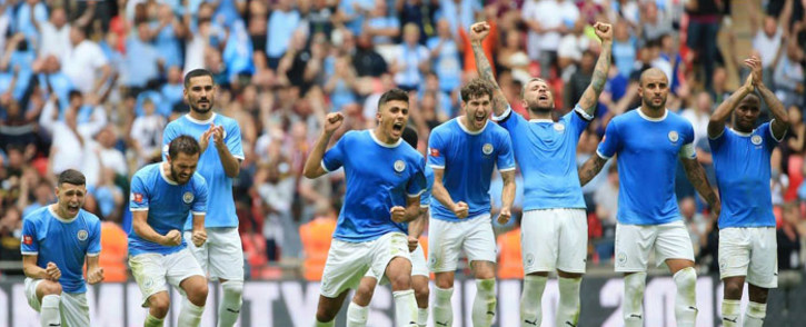 Manchester City players celebrate a successful penalty kick in the shootout with Liverpool during their Community Shield match at Wembley Stadium in London on 4 August 2019. Picture: @ManCity/Twitter