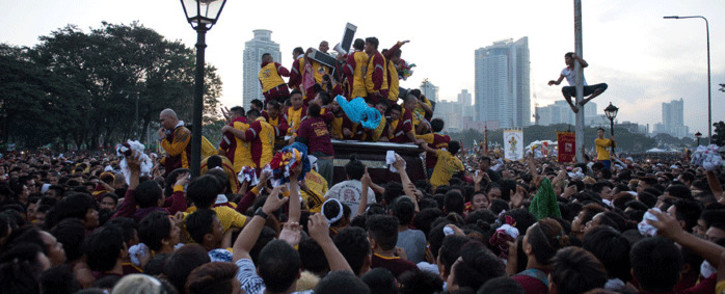 Devotees join the annual procession with the religious icon of the Black Nazarene (C) in Manila on January 9, 2017. Picture: AFP