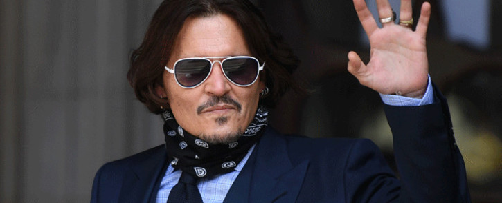 FILE: US actor Johnny Depp arrives to attend the sixth day of his libel trial against News Group Newspapers at the High Court in London, on 14 July 2020. Picture: AFP