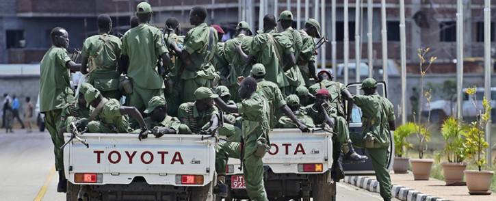 Sudan Peoples Liberation Movement in Opposition (SPLM-IO) soldiers loyal to rebel leader Riek Machar sit in vehicle at the airport in Juba on 20 April, 2016. Picture: AFP.