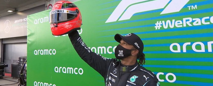 Lewis Hamilton equals the legendary Michael Schumacher's win tally, earning a special prize from Michael's son, Mick. Picture: @F1/Twitter