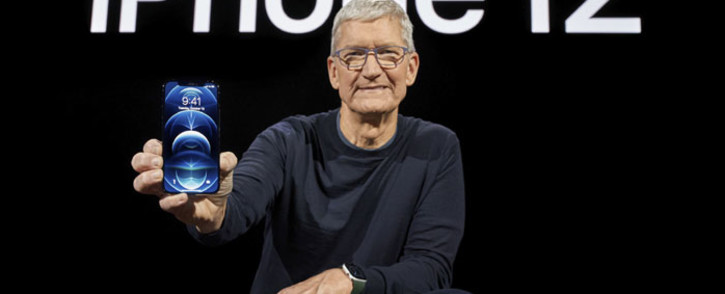 In this photo released by Apple, Apple CEO Tim Cook holds up the all-new iPhone 12 Pro during an Apple event at Apple Park in Cupertino, California on 13 October 2020. Picture: AFP
