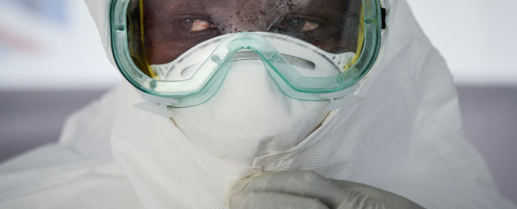 FILE: In this file photo taken on 12 December 2018 a member of the medical staff of the Ebola Treatment Unit (ETU) puts on her Personal Protective Equipment (PPE) during a weekly rehearsal at the Bwera General Hospital in Bwera bordering with DRC, western Uganda. Picture: AFP