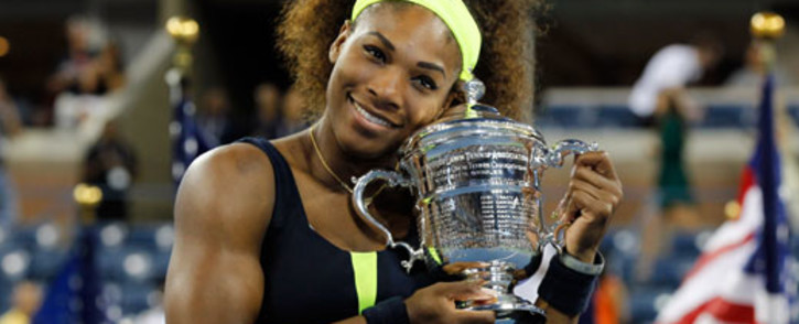Serena Williams of the United States hugs the championship trophy after defeating Victoria Azarenka of Belarus to win the women's singles final match on Day Fourteen of the 2012 U.S. Open. Picture: AFP.