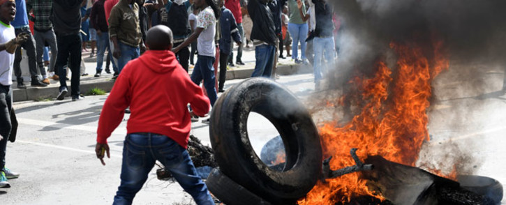 FILE: Alexandra township residents burn tyres in the middle of the street as they clash with the Johannesburg Metro Police on 3 April 2019 in Johannesburg, South Africa. Picture: AFP
