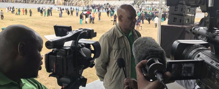 Amcu President Joseph Mathunjwa addresses the media at Masizakhele Stadium in Driefontein amid a strike in the gold sector. Picture: @_AMCU/Twitter