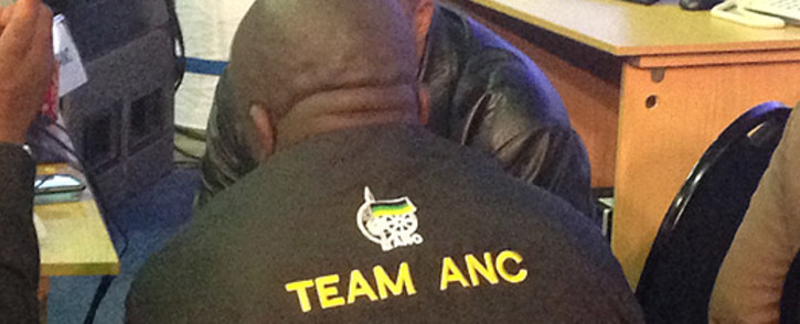 A member of The African National Congress sits at his party's station in the IEC's national results centre in Pretoria. Reinart Toerien/EWN.