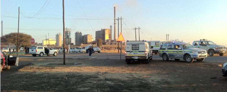 Police monitor the area near the entrance to Lonmin mine in Marikana. Picture: Gia Nicolaides/EWN