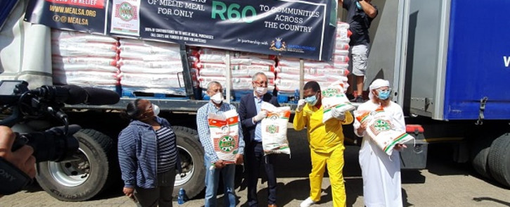 Acting Gauteng Social Development MEC Panyaza Lesufi (yellow overall) on 15 April 2020 received donations from social partners and business at the central food bank warehouse in Booysen, Johannesburg. Picture: @gpgSocDev/Twitter