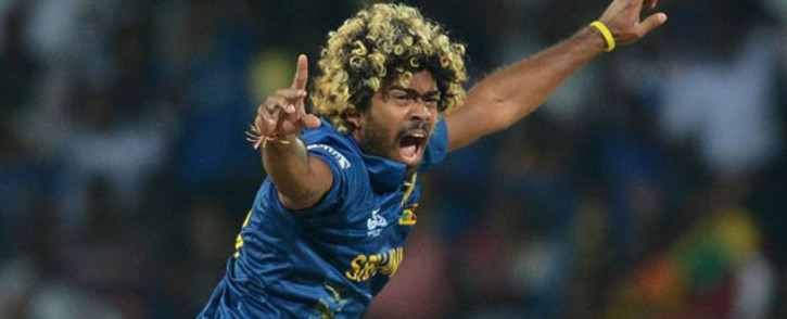 Sri Lanka's cricketer Lasith Malinga celebrates the wicket of England cricketer Alex Hales during the ICC Twenty20 Cricket World Cup's Super Eight match between England and Sri Lanka at the Pallekele International Cricket Stadium in Pallekele on 1 October, 2012. Picture: AFP.