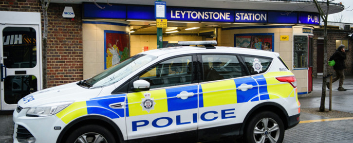 FILE: A police car is seen parked outside Leytonstone station in north London on 6 December, 2015. Police were called to reports of people being attacked at Leytonstone around 19:00 GMT on 5 December. Picture: AFP.