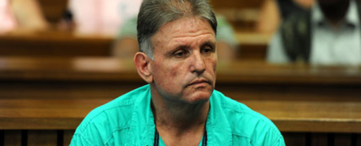 Johan Kotze appears in the North Gauteng High Court on Tuesday, 20 November 2012. He's accused of orchestrating the gang-rape of his ex-wife and of killing his stepson. Picture: Werner Beukes/SAPA.