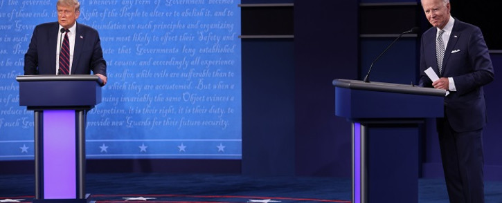 President Donald Trump and Democratic presidential nominee Joe Biden look out to the audience at end of the first presidential debate at the Health Education Campus of Case Western Reserve University on September 29, 2020 in Cleveland, Ohio. Picture: AFP