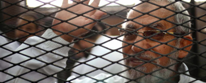 Mohamed Badie has been charged with numerous crimes, including inciting violence. Picture: AFP.