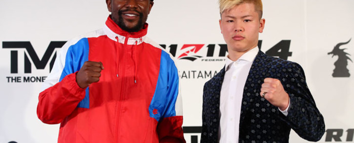 In this file handout photo taken by Rizin Fighting Federation on 5 November 2018, US boxer Floyd Mayweather Jr. (L) poses with Japanese kickboxer Tenshin Nasukawa (R) during a press conference in Tokyo to announce their fight. Picture: AFP.