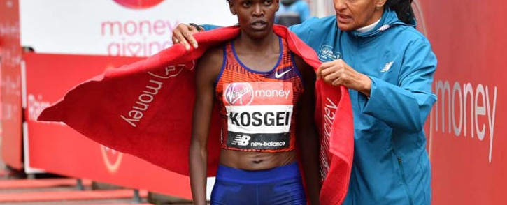 FILE: Kenya's Brigid Kosgei is wrapped in a towel after winning the elite women's race of the 2019 London Marathon in central London on April 28, 2019. Picture: AFP