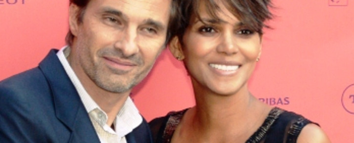 """US actress and guest of honour Halle Berry (R) poses with her fiance French actor Olivier Martinez, on 13 June,2013 during a photocall upon their arrival for the """"Toiles enchantees"""" event, as part of the Champs-Elysees film Festival in Paris. Picture:AF"""