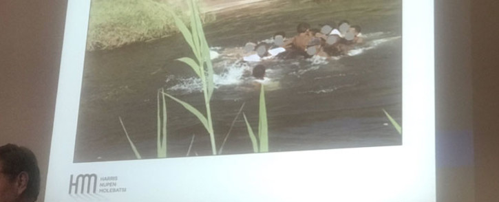Peter Harris from Harris Niobe Molebatsi shows a slide of the water activity that the Parktown Boys' High pupils participated in at the Nyati Bush and River Lodge where Enock Mpianzi died. Picture: EWN
