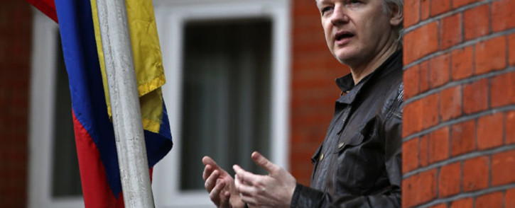 In this file photo taken on 19 May 2017 Wikileaks founder Julian Assange speaks from a balcony at the Embassy of Ecuador in London. Picture: AFP