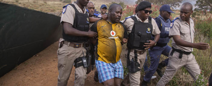 Police arrest drivers who were involved in taxi violence in the township of Atteridgeville near Pretoria on 29 May 2018. Picture: Ihsaan Haffejee/EWN