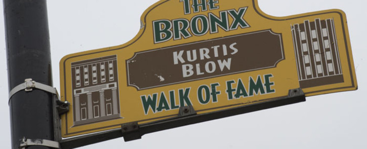FILE: A sign honouring hip-hop pioneer Kurtis Blow hangs from a lamp post as part of the Bronx Walk of Fame in the Bronx in New York. Picture: AFP