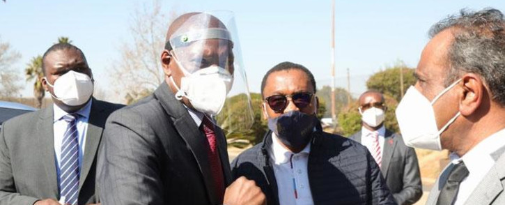 Health Minister Zweli Mkhize and Gauteng Health MEC Bandile Masuku (centre) arrive at the Nasrec field hospital on 20 July 2020 to inspect its state of readiness amidst the province's increase in coronavirus cases. Picture: Kayleen Morgan/EWN