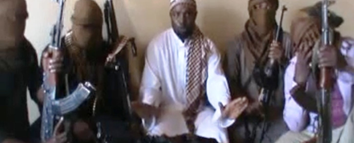 FILE: A screengrab taken from a video released on You Tube on April 12, 2012 apparently shows Boko Haram leader Abubakar Shekau (C) sitting flanked by militants.Picture: AFP.