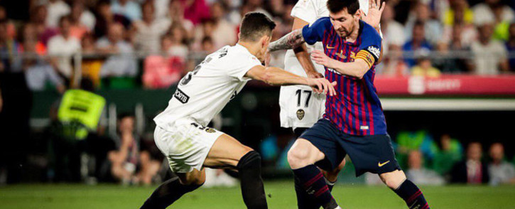 Barcelona's Lionel Messi takes on two Valencia defenders in the Copa del Rey final on 25 May 2019. Picture: @FCBarcelona/Twitter
