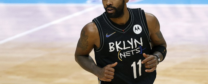 In this file photo, Kyrie Irving #11 of the Brooklyn Nets runs the court during the fourth quarter of their game against the Charlotte Hornets at Spectrum Center on 27 December 2020 in Charlotte, North Carolina. Picture: AFP